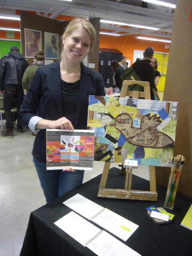 A smiling blonde Rebecca showing her project artwork