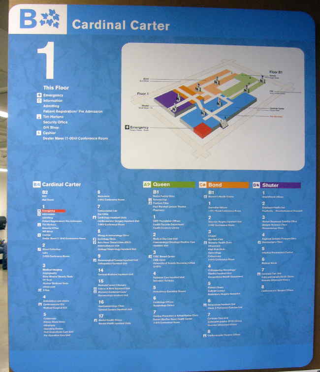 Large blue sign with white type and a map