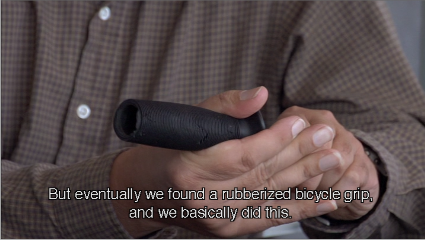 Man holds bicycle grip on utensil: But eventually we founod a rubberized bicycle grip, and we basically did this