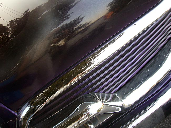 Viewed at an angle, a purple radiator grille sits inside chrome trim