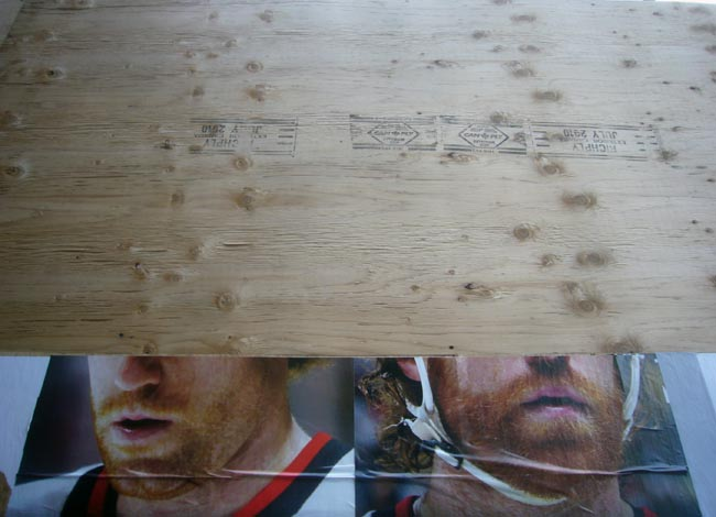 Red-bearded hockey players' chins behind plywood hoarding
