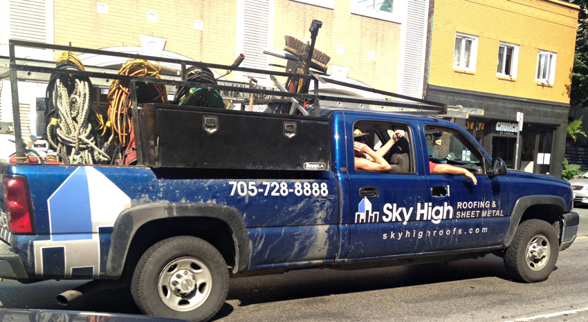 Sky High Roofing & Sheet Metal king-cab truck with guys leaning arms out the side windows