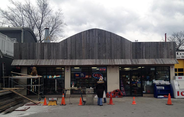 A-frame sign over convenience store is nothing but vertical grey boards