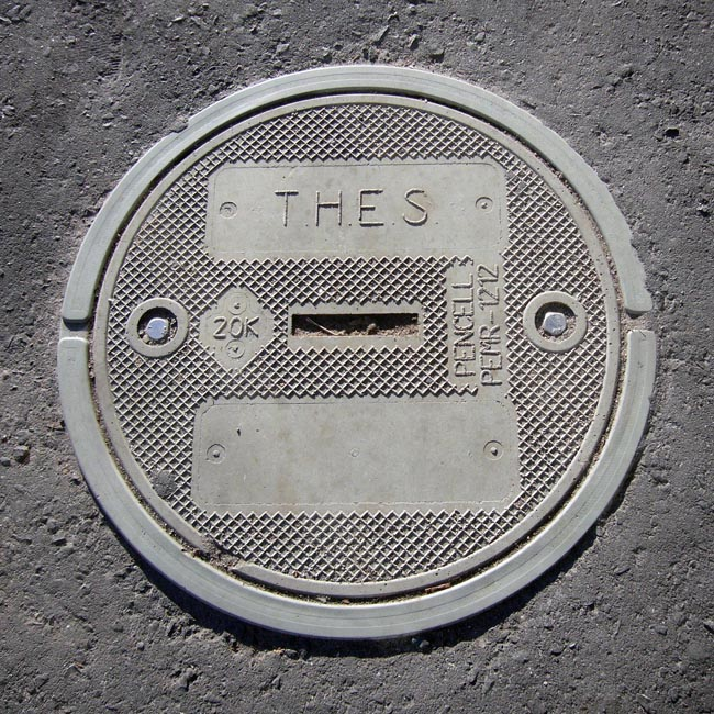 Manhole cover is inscribed T.H.E.S.