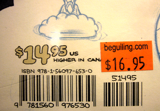 Handwritten price and other labels alongside an orange tag from Beguiling: $16.95