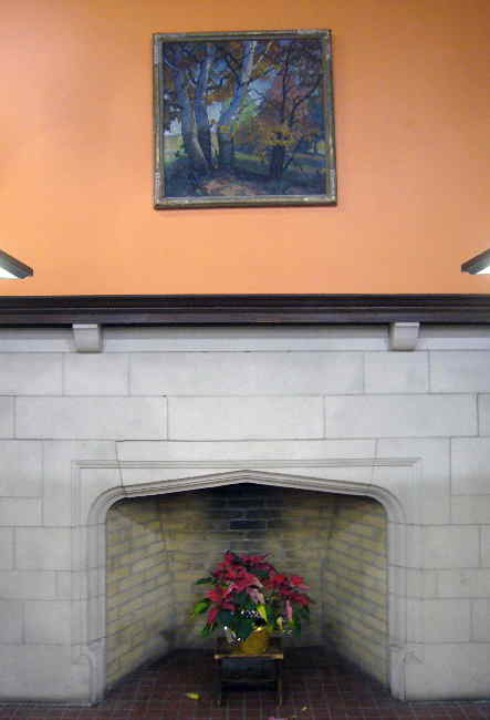 Fireplace contains a poinsettia in its hearth