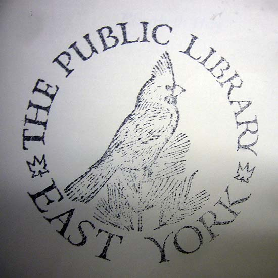 Woodcut of a cardinal encircled by the words THE PUBLIC LIBRARY EAST YORK