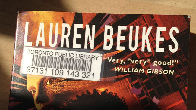 Book with simple Toronto Public Library barcode