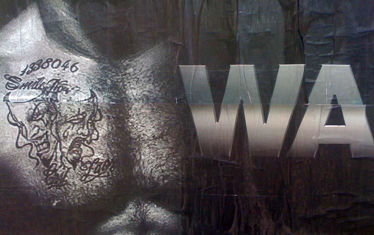 Hairy, muscled, tattooed pectoral in B&W photo alongside WA