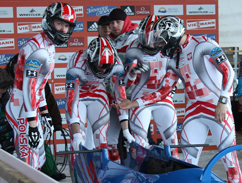 White-and-silver uniforms eith mottled overlapping red and pink squares and red and grey chevrons