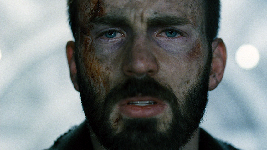 Chris Evans looking straight at us: Blue eyes, dirt face, deep black beard