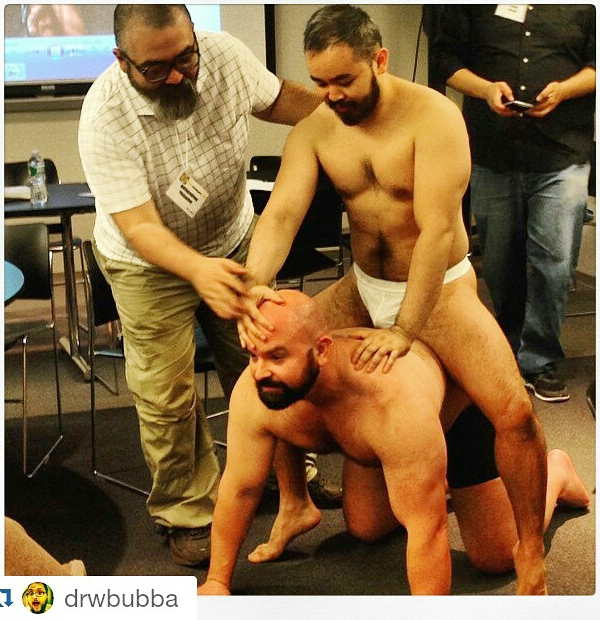 At a life-drawing event, Japanese man sits on Steve's back as Gengoroh Tagame positions them both