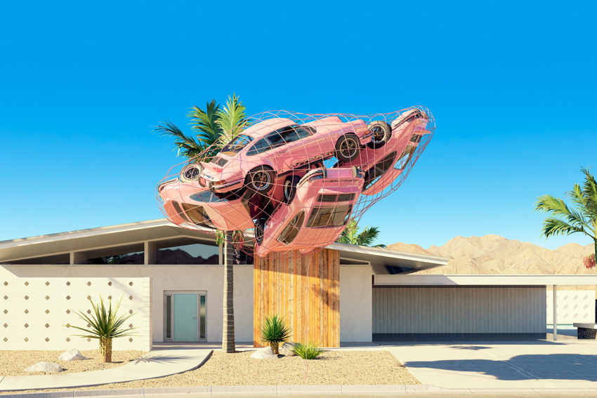 Pink 911s appear to be wrapped in a net and floating ten feet off the ground in front of a Modernist mansion
