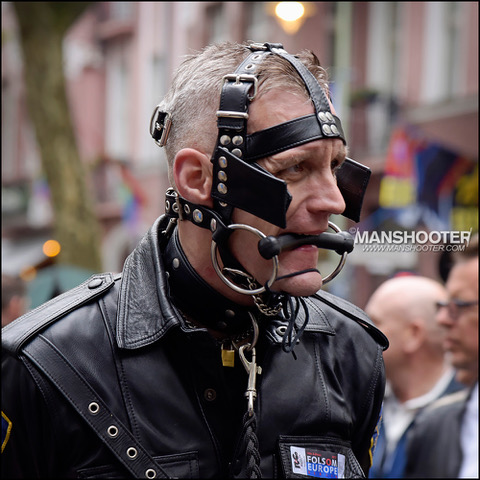 Man in bridle (biting between teeth) that also straps around head, neck