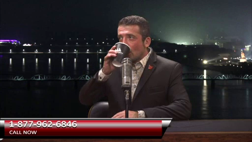 Malice sipping a drink on the set of his show