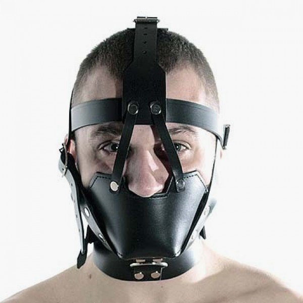 Shirtless man in muzzle covering lower cheeks, mouth, jaw, with straps up and around head