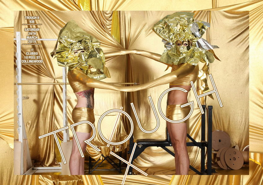 Models in gold-lamé jockstraps and gold-foil assemblages on heads have their hands joined together by golden stockings