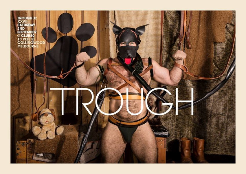 Guy in pup mask and jockstrap does double-bicep pose against fur draperies. TROUGH reads the legend in Avant Garde