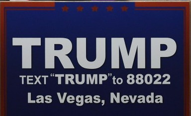 "TRUMP in Arial (but serif quotation marks): TRUMP TEXT ""TRUMP"" to 88022 Las Vegas, Nevada"