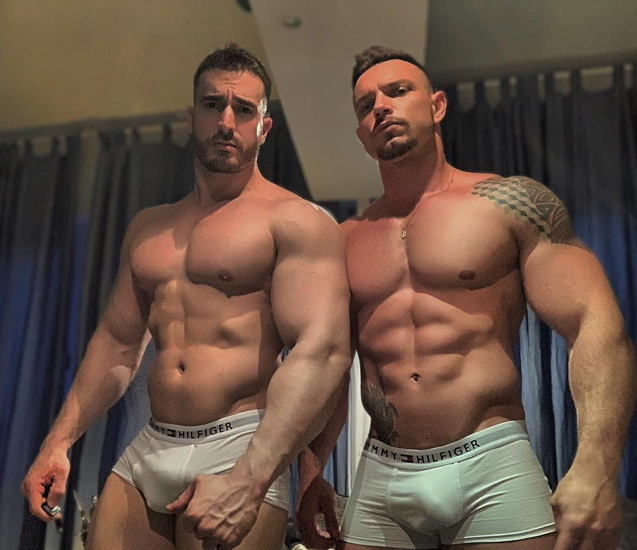 Two overmuscled men in white Hilfiger briefs